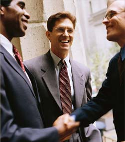job applicant shakes hands with employers