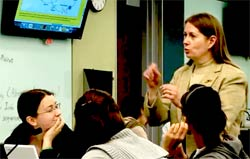 Assoc Dean Robin Wright (U Minn) roaming among student tables