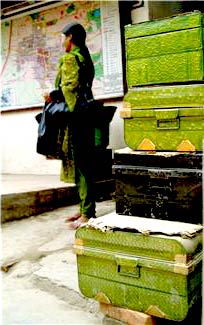 woman waiting with luggage