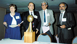 orum of Physics and Society Chair Ruth Howes presented the Forum Award (now the Burton Forum Award) in 1992 to (L-R) Fernando Barros, Luis Maspari, Alberto Ridner and Luis Rosa, who successfully worked with their governments to renounce nuclear weapons and to mutually inspect their nuclear facilities.