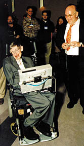 fest01.jpg - 22197 Bytes Science magician Bob Friedhoffer elicits a smile from 1999 Lilienfeld Prizewinner Stephen Hawking
