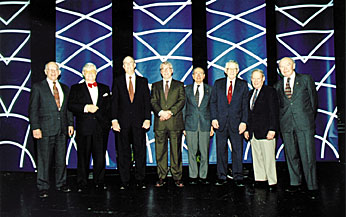 Science advisors past and present take a breather from policy issues at the APS Centennial meeting in Atlanta: (from left) Jack Gibbons, D. Allan Bromley, Bill Graham, Jay Keyworth, Frank Press, Guy Stevers, Ed David, and Don Hornig. Photo by: Steven J. Swieter of Swieter Images