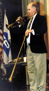 Brian Holmes employs various brass instruments to demonstrate the basic physics principles behind them.