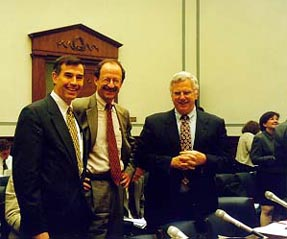 Representative Rush Holt joins NIH Director Harold Varmus (center) and National Academy President Bruce Alberts (right) in testifying at a Congressional hearing on public access to scientific data.