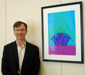 Eric Heller stands beside one of his creations at APS Headquarters. (Photo by Barrie Ripin)