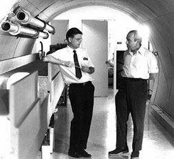 Robert R. Wilson (left) confers with Edwin L. Goldwasser during the early days at the National Accelerator Laboratory.