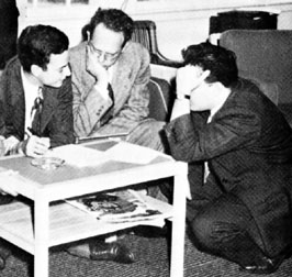 Discussing physics informally (left to right): R. Feynman, H. Feshbach, J. Schwinger. Reprinted from Shelter Island II