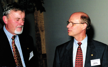 Albert Narath (l) speaks to John Pace VanDevender (r) as Fellows enjoy each other's company at the reception.