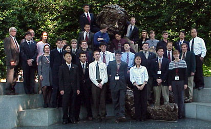The 2001 US Physics Team and their coaches gather in front of the National Academy in the friendly shadow of Albert Einstein.