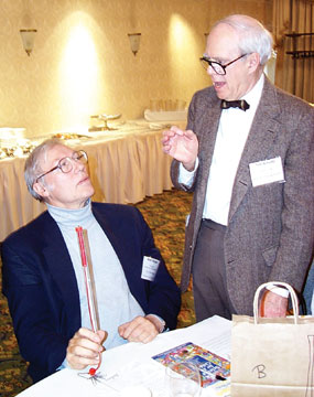 Ted Schultz, right, makes a point to Wolf Berger at one of the TSA Institutes