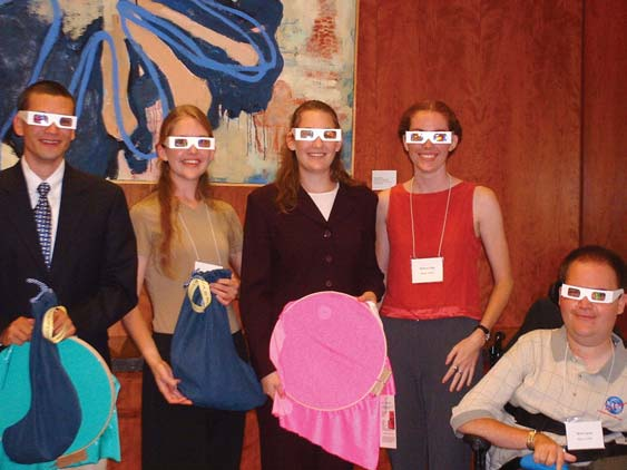 The 2002 SPS summer interns at their closing session on August 13. The group is modeling the light diffracting glasses and holding equipment that is part of the educational SPS Outreach Catalyst Kit (SOCK) Tabeling and Glas put together. From left to right: Jason Tabeling, Lauren Glas, Eva Wilcox, Katie Peek, and Brent Janus.
