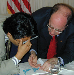 Lamb goes over details of the report with journalist Yoichi Nishimura of Asahi Shimbun