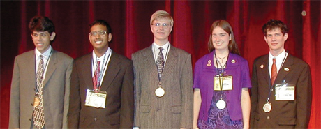 Victorious members of the US Physics team line-up with their medals on display
