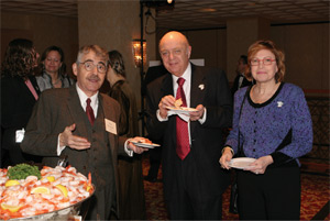 APS President Marvin Cohen (center) and his wife Suzy share refreshments and an anecdote or two with 'Paul Ehrenfest'.