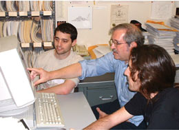 Michael Peskin (center) and colleagues use the miracle of electronic publishing to bring to their desktop a classic 1969 paper by Kenneth Wilson on the operator product expansion.