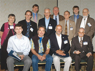 Photography Seated (l to r): Andriy Kurylov; Robert Austin; Pier Oddone; Martin Klein. Standing (l to r): Cecile DeWitt-Morette; Lawrence Krauss; Ronald Walsworth; Daniel Kleppner; Roy Holt; David Vaughan; Jonathan Heckman; Keith Symon. Not shown: Susumu Okubo, Stanford Woosley. Photo Credit: Universal Convention Photography