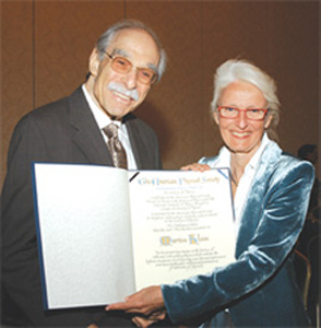 The APS has awarded the Pais Prize, named after the late distinguished physicist and historian Abraham Pais, for the first time at its April Meeting in Tampa. The Prize recognizes outstanding scholarly achievements in the history of physics, and the inaugural recipient was Martin J. Klein, Eugene Higgins Professor Emeritus of Physics and History of Science at Yale. In the photo Klein (left) and Ida Nicolaisen, widow of Abraham Pais, hold the Pais Prize certificate. The Prize was established in collaboration with the Center for History of Physics of the American Institute of Physics.