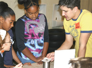 Students at Jonas C. Salk elementary school do hands-on physics at the Purdue demo show.