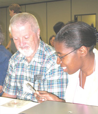 At an APS High School Physics Teachers' Day workshop in Dallas, William Griffith and Kendra Bonnet explored fractal patterns in a crystal that they had just grown. The workshop was led by Richard Olenick of the University of Dallas.