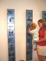 18-month old Chloe Rand got a chance to feel the glass panels of the art work, 'A new World View