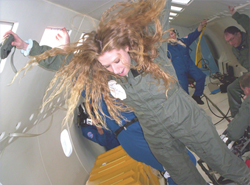 Teacher Lori DiLisi of Beaumont High School in University Heights, Ohio flies through the air with the greatest of ease in the weightless environment aboard NASA's reduced gravity C-9 airplane.