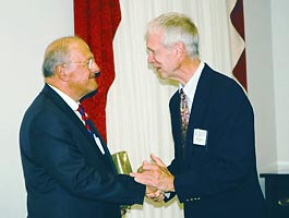 On September 13, APS hosted a reception on Capitol Hill in honor of the retiring Chairman of the House Science Committee, Sherwood Boehlert (R-NY). The event was attended by several members of Congress, Congressional staff, members of the Administration, and numerous representatives of the Washington science policy community. In the picture, APS President John Hopfield (right) expresses his appreciation to Boehlert for years of staunch support for science. As a memento of the occasion, Hopfield presented Boehlert with a special doorstop edition of 'The Physical Review: the First Hundred Years' (visible under Boehlert's left arm)