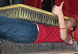 Becky on bed of nails