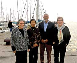 Beverly Berger, Aihua Xie, Kennedy Reed and Heidi Schellman near the International Center of Theoretical Physics (ICTP)