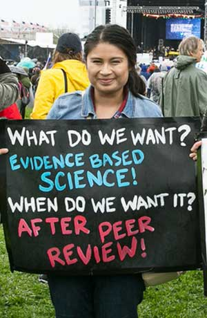 woman holding up science sign