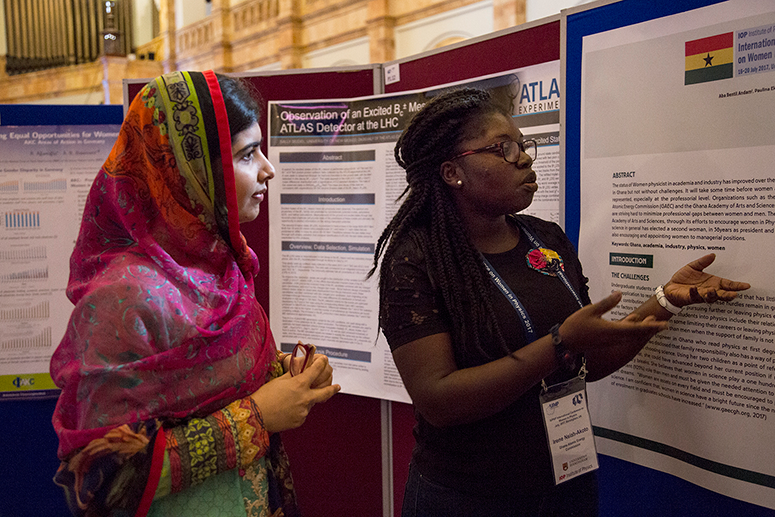 Nobel laureate Malala Yousafzai listens to a poster presentation by Irene Nsiah-Akoto