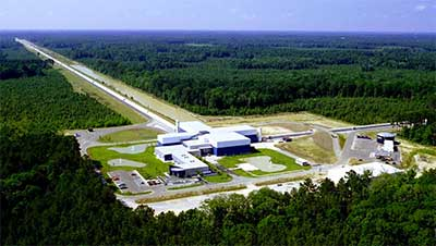 The LIGO Laboratory operates two detector sites, one near Hanford in eastern Washington, and another near Livingston, Louisiana. This photo shows the Livingston detector site. The detector arm stretching off in the distance is 4 km long.