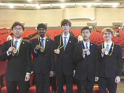 US Physics Olympiad Team showing gold and silver medals